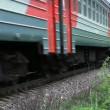 Fast passenger train rides through the Russian countryside — Stock Video #25966981