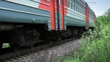 Fast passenger train rides through the Russian countryside — Vidéo