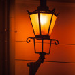 Royalty-Free Stock Photo: Old street lamp light on the wall at night. Tallinn, Estonia
