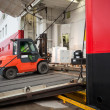 Lift truck unloads big passenger ship through opened side ramp — Stock Photo