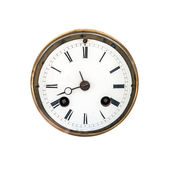 Front view of an ancient clock dial with roman signs isolated on white — Stock Photo