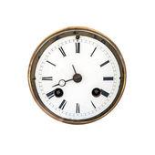 Vista frontal de um mostrador de relógio antigo com romanos sinais isolado no branco — Foto Stock