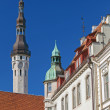 Stock Photo: Street fragment with tall town hall tower. Old Tallinn, Estonia