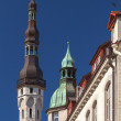 Stock Photo: Old Tallinn street fragment with tall town hall tower