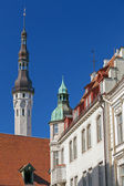 Street fragment with tall town hall tower. Old Tallinn, Estonia — Stock Photo