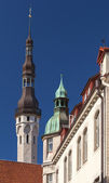 Old Tallinn street fragment with tall town hall tower — Stock Photo