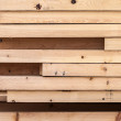 Pile of new wooden boards on a storage. Side background texture — Stock Photo