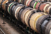 Trains of colorful oil tank wagons — Stock Photo