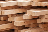 New wooden boards on a storage. Abstract background — Stock Photo