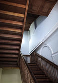 Abstract architecture fragment with wooden staircase — Stock Photo