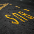 Yellow bus stop marking on urban asphalt road — Stock Photo