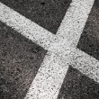 Stock Photo: Crossing of white road lines on dark asphalt