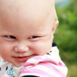 Funny smiling baby girl outdoor summer closeup portrait — Stock Photo
