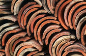 Stack of old red roof tiles — Stock Photo