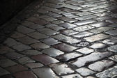 Old shining stone pavement surface background — ストック写真