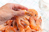 Big prepared shrimp in man's hand — Stock Photo
