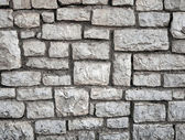 Old gray stone wall background texture — Foto Stock