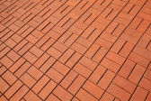 Background texture of red cobblestone pavement — 图库照片