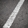 Old white line perspective. Road marking — Stockfoto