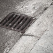 Drainage cover on the road side — Stock Photo