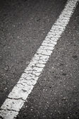 Old white line perspective. Road marking — Stok fotoğraf