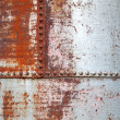 Old rusted metal background texture with rivets — Stock Photo