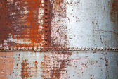 Old rusted metal background texture with rivets — Foto de Stock