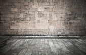 Stone wall and pavement of vintage town square — Stock Photo
