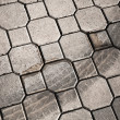 Gray urban cobblestone with tire track — Stockfoto