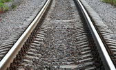 Railway perspective with gray gravel on sides — Foto de Stock