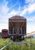 Cargo railway car stands on station. Front view — Stok fotoğraf