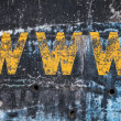 Dark blue concrete wall with yellow www label. Photo background texture — Stock Photo