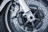 Motorcycle wheel with brake. Closeup monochrome photo — Stock Photo