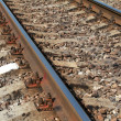 Railway closeup details photo with gray gravel — Foto de Stock