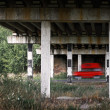Red van car goes fast under old bridge — Stock Photo