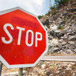 Red Stop traffic sign on rural roadside — Stock Photo #29931481