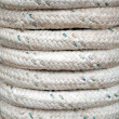 Bundle of gray marine rope closeup background texture — Stock Photo