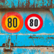 Stock Photo: Speed limit signs on the back of old blue truck