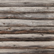 Wooden wall of rural house made of logs. Photo background texture — Stock Photo