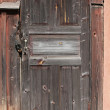 Stock Photo: Old brown locked wooden door background texture