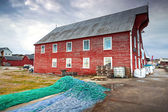 Red wooden fishing barn with drying nets. Rorvik town, Norway — Stock Photo