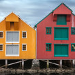 Red and yellow coastal wooden houses in Norway — Stock Photo
