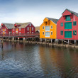 Red and yellow wooden houses in coastal Norwegian fishing village. Rorvik, Norway — Stock Photo