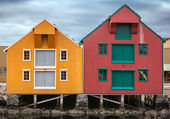 Red and yellow coastal wooden houses in Norway — Stok fotoğraf