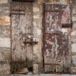 Locked ancient wooden doors in gray stone wall. Perast town, Montenegro — Stock Photo
