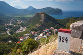 White and red kilometer stone post on the roadside in Montenegro — Stock Photo