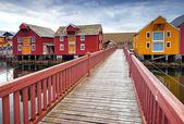 Wooden bridge and colorful houses in coastal Norwegian fishing village. Rorvik, Norway — Stock Photo