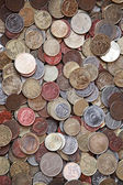 Vertical photo background with small coins of different European countries — Stockfoto