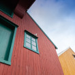 Fragment of red and yellow wooden houses in Norway — Stock Photo