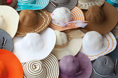 Colorful female summer hats lie on the counter — 图库照片